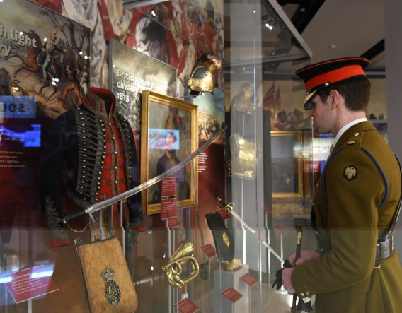 Officer viewing army uniforms