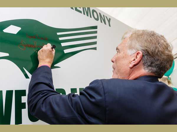 Sir Trevor Brooking signing the Club logo. Courtesy of Kewford Eagles Football Club