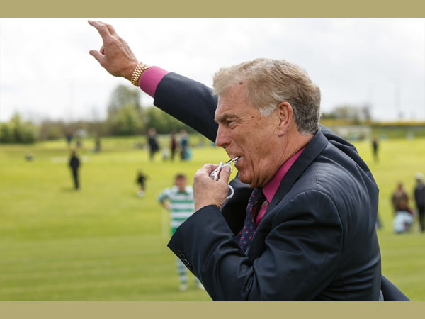 Sir Trevor Brooking blowing the first whistle. Courtesy of Kewford Eagles Football Club