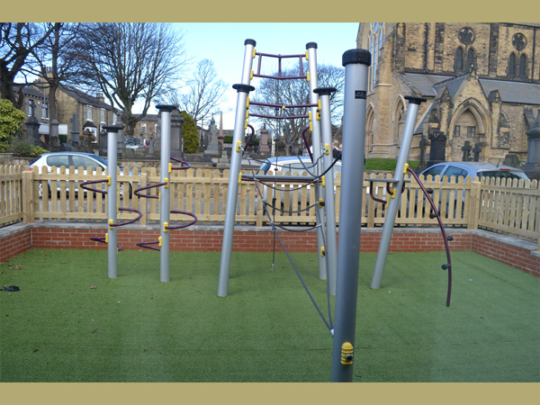 Trinity Centre, Ossett. Outdoor play area with play equipment.
